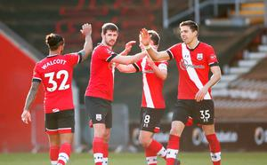 Southampton's Jan Bednarek, Jack Stephens and Theo Walcott celebrate after the match