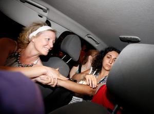 Naghemeh King (R), mother of Ashya King, is comforted by a friend inside a car after she and her husband were released from prison in Soto del Real, near Madrid, September 2, 2014