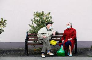 A man and a woman have a conversation on Main street, Co. Cavan, before the county moved to Level 4 of Ireland's Covid-19 plan. Photo: Brian Lawless/PA Wire