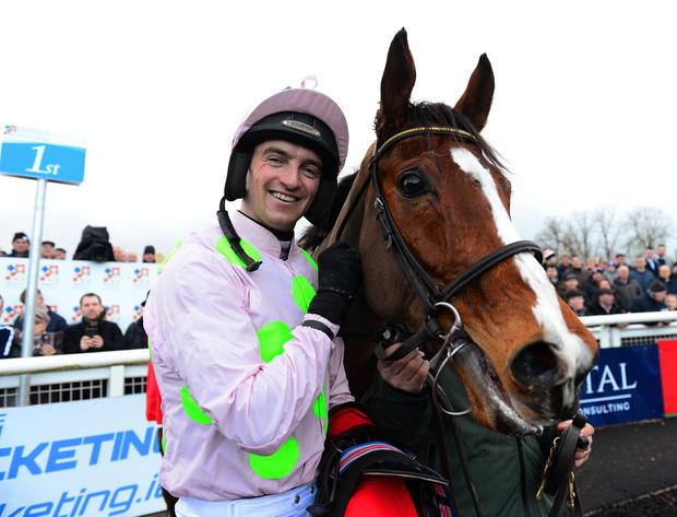 Patrick Mullins celebrates a job well done with the evergreen Faugheen in Limerick. Photo: Healy Racing