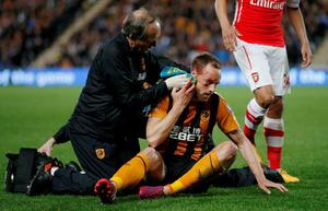 Hull City's David Meyler receives treatment after sustaining a facial injury Action Images via Reuters / Lee Smith