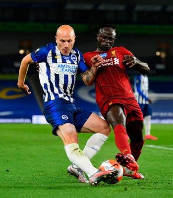 Brighton and Hove Albion's Aaron Mooy and Liverpool's Sadio Mane battle for control of the ball. Photo: Daniel Leal Olivas/NMC Pool/PA Wire