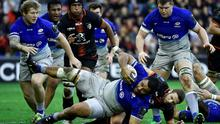 Saracens' flanker from England Billy Vunipola (c, down) breaks away from Toulouse's French scrum-half Gerd Muller Photo:AFP/Getty
