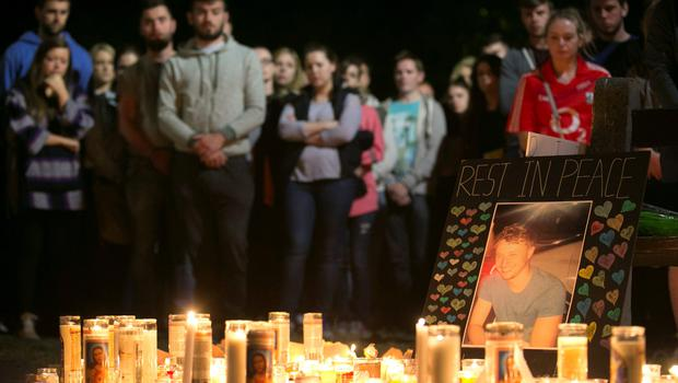 A picture of Niccolai Schuster is seen at a memorial during a candlelight vigil for the victims of the Berkeley balcony collapse in California