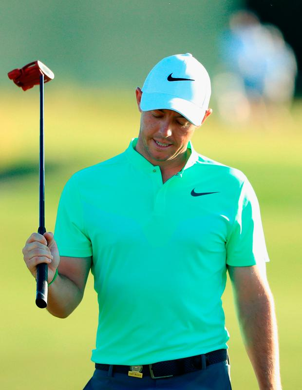 Rory McIlroy reacts after his putt on the 18th green