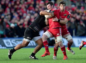 Peter O'Mahony  is tackled by Billy Vunipola of Saracens  during the European Rugby Champions Cup match at Allianz Park