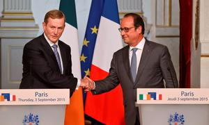 Irish Prime Minister Enda Kenny, left, and French President Francois Hollande shake hands after a joint media conference at the Elysee Palace in Paris, France, Thursday, Sept. 3, 2015. (AP Photo/Michel Euler)