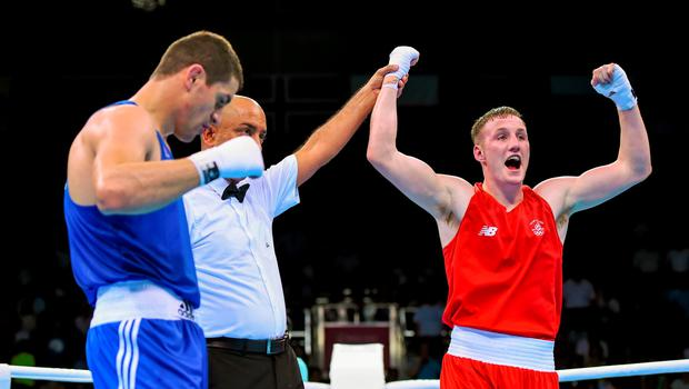 27 June 2015; Michael O'Reilly, Ireland, is announced victorious over Zaybula Musalov, Azerbaijan, by referee Mik Basi, following their Men's Boxing Middle 75kg Final bout. 2015 European Games, Crystal Hall, Baku, Azerbaijan. Picture credit: Stephen McCarthy / SPORTSFILE
