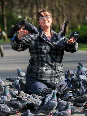 Siobhan Kiely from Prosperous enjoys the good weather in St Stephen's Green in Dublin yesterday.