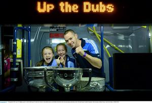 Lizzy O'Callighan, aged 12, and Zoe Duff, aged 13, both from Clontarf, on the Dublin team bus with Dublin's Dean Rock after the homecoming celebrations of the All-Ireland Senior Football Champions. Merrion Square, Dublin.