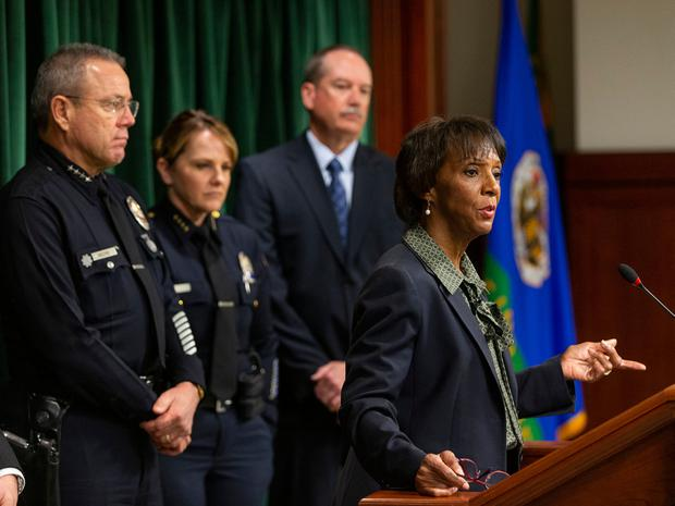Los Angeles County District Attorney Jackie Lacey, right, at podium, announces that film producer Harvey Weinstein has been charged with raping a woman and sexually assaulting another in separate incidents over a two-day period in 2013, at a news conference at the Hall of Justice in Los Angeles, Monday, Jan. 6, 2020. (AP Photo/Damian Dovarganes)