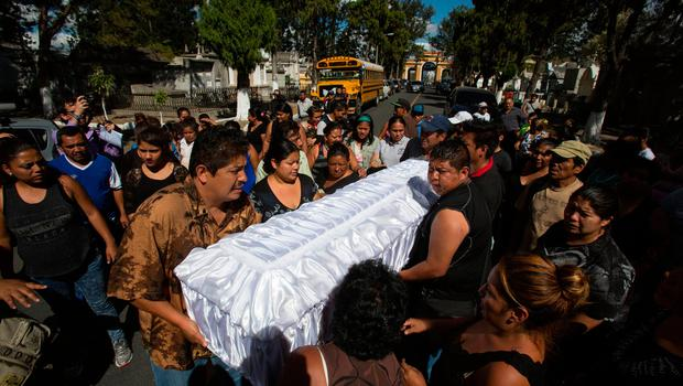 People carry the coffin containing the remains of 14-year-old Madelyn Patricia Hernandez Hernandez, a girl who died in a fire at the Virgin of the Assumption Safe Home, at the Guatemala City's cemetery (AP Photo/Moises Castillo)