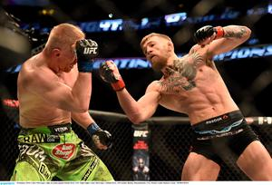 McGregor, right, in action against Dennis Siver. UFC Fight Night, Conor McGregor v Dennis Siver, TD Garden, Boston, Massachusetts, USA. Picture credit: Ramsey Cardy / SPORTSFILE