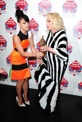 Lily Allen (left) and Debbie Harry fighting for the Godlike Genius Award at the 2014 NME Awards, at Brixton Academy, London. PRESS ASSOCIATION Photo. Picture date: Wednesday February 26, 2014. Photo credit should read: Ian West/PA Wire