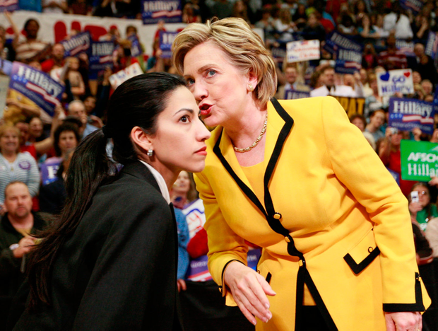Email trail: Democratic presidential candidate Hillary Clinton and long-term aide Huma Abedin on the campaign trail. A laptop Abedin shared with her former husband, Anthony Weiner, is thought to have triggered the latest furore Photo: AP Photo/Charles Dharapak