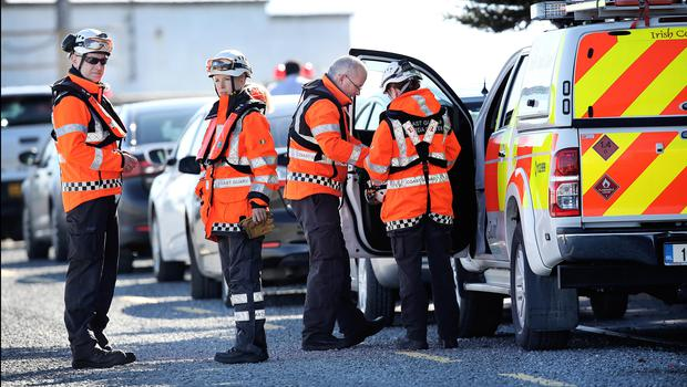 Members of the Irish Coast Guard at Blacksod Pier as the search continues for Rescue 116 along Blacksod coastline in Co Mayo. Pic Steve Humphreys 25th March 2017