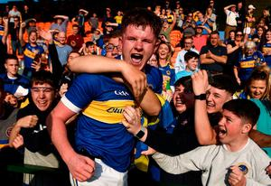 Kevin Robinson celebrates with Maghery supporters. Photo: Sportsfile