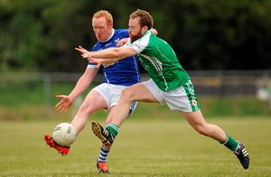 London's Brian Collins tries to block a pass by Cian Mackey