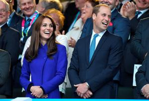 Catherine, Duchess of Cambridge and Prince William, Duke of Cambridge attend the Rugby World Cup 2015 match between England v Fiji at Twickenham Stadium on September 18, 2015 in London, England.  (Photo by Karwai Tang/WireImage)