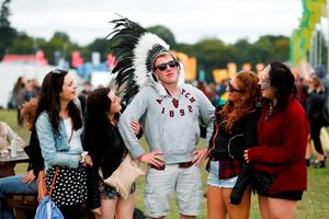 FAO DAVID CONACHY : Pictured (l-r) was festival goers Emma Buckley, Lisa O'Brien, Robbie Holloway, Celine Holloway and Amy Fagan from Westmeath at Electric Picnic, Stradbally, Co Laois. Picture Conor McCabe.