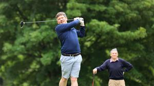 Herald GAA reporter Conor McKeon tees off on the 11th, as his dad Gay looks on at the Hermitage Golf club in Lucan last month. Picture Credit: Frank McGrath
