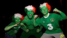 Republic of Ireland fans Shane Peppard (centre) with his son Clayton, aged 9, (left) and nephew Sean, 12, from Clondalkin during the UEFA Euro 2016 Qualifying Playoff second leg in Dublin. Photo: Brian Lawless/PA Wire.