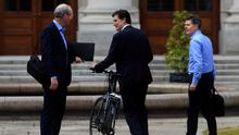 Pedal power: Tánaiste Simon Coveney, Green Party leader Eamon Ryan and Finance Minister Paschal Donohoe meet at Government Buildings, Dublin, yesterday. Photo: Gareth Chaney, Collins