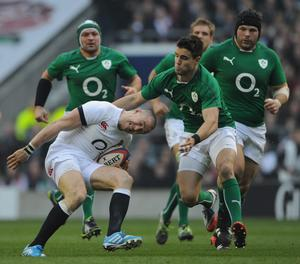 Mike Brown of England is tackled by Conor Murray