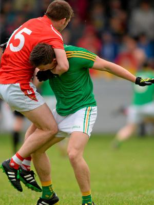 Louth's Ronan Holdcroft involved in a tussle off the ball with Leitrim's Mathew Murphy