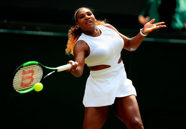 Serena Williams in action against Carla Suarez Navarro on day seven of the Wimbledon Championships. Photo: Mike Egerton/PA Wire