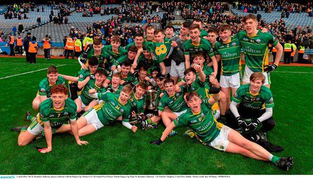 The St. Brendan's Killarney players celebrate with the Hogan Cup