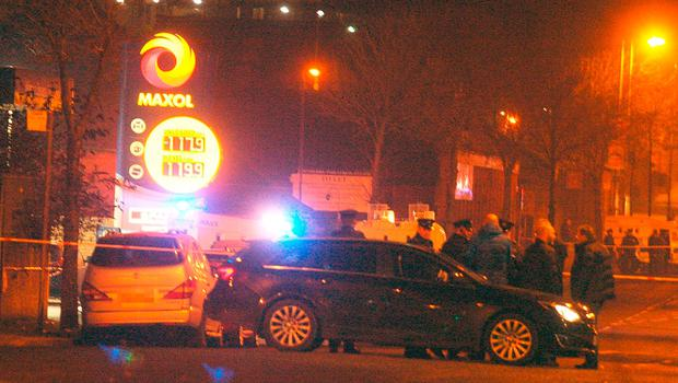 The scene at a petrol station on the Crumlin Road in north Belfast where a police officer was shot in the arm. Photo: PA