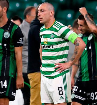 Scott Brown looks dejected after Celtic's Champions League defeat at Celtic Park