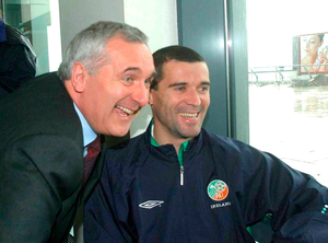 Bertie Ahern is all smiles with Roy Keane in May 2002 at Dublin Airport prior to their departure for Saipan. Photo: David Maher / Sportsfile