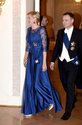 President of Poland Andrzej Duda and his wife Agata Kornhauser-Duda arrive for the state dinner at the Presidential Palace in Helsinki, Finland, on October 24, 2017.  / AFP PHOTO / Lehtikuva / Martti Kainulainen
