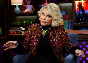 """In this Feb. 16, 2012 photo provided by Bravo, Joan Rivers appears on the """"Watch What Happens Live"""" show in New York. Rivers, the raucous, acid-tongued comedian who crashed the male-dominated realm of late-night talk shows and turned Hollywood red carpets into danger zones for badly dressed celebrities,  died Thursday, Sept. 4, 2014"""