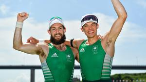 Paul O'Donovan, left, and Fintan McCarthy celebrate after winning an Olympic gold medal in Tokyo. Photo by Seb Daly/Sportsfile