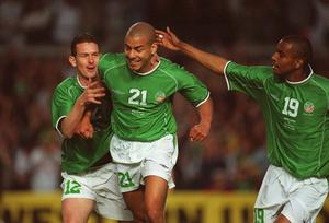 The Republic of Ireland's Stephen Reid (21) celebrates with team-mates Clinton Morrison (19) and Mark Kinsella (12) after scoring a goal against Nigeria before the 2002 World Cup