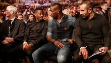 Footballer Mario Balotelli watches during the WBO & WBA Intercontinental Cruiserweight Title fight at the Liverpool Echo Arena