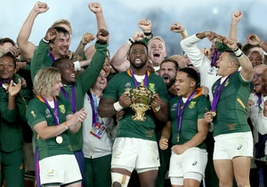 Siya Kolisi, the South Africa captain, raises the Webb Ellis Cup after their World Cup final victory over England last November. Photo: David Rogers. Photo: David Rogers/Getty Images