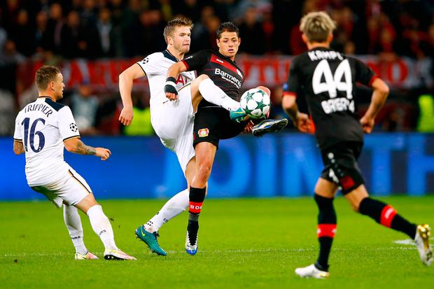 Bayer Leverkusen's Javier Hernandez in action with Tottenham's Eric Dier Reuters / Wolfgang Rattay Livepic EDITORIAL USE ONLY.