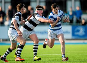 Niall Brady, Blackrock College, is tackled by Luan McGrath, Belvedere