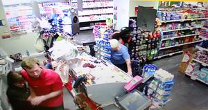 FROM CCTV....The lone raider knocks an elderly Woman over at The Glasnevin Avenue Spar. 1 of series.