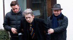 Shane MacGowan leaves his home in Ballsbridge to attend the funeral of former Pogues manager Frank Murray. Photo: Tony Gavin