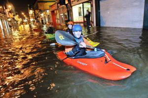 Basie Olivier from CIT Kayak Club takes a field trip during heavy flooding on Oliver Plunkett street, Cork city