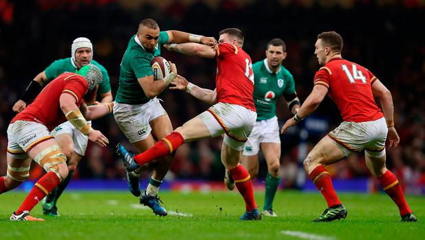 Ireland's Simon Zebo (centre left) is tackled by Wales' Scott Williams (centre)