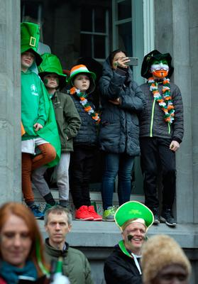 Spectators watch from a vantage point in Dame Street during the St Patrick's Day parade in Dublin. Photo: Tony Gavin 17/3/2017