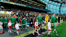 Robbie Keane, Republic of Ireland captain, leads the team out for the start of the game against Georgia