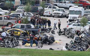 Authorities investigate a shooting in the parking lot of the Twin Peaks restaurant Sunday, May 17, 2015, in Waco, Texas. (AP Photo/Jerry Larson)