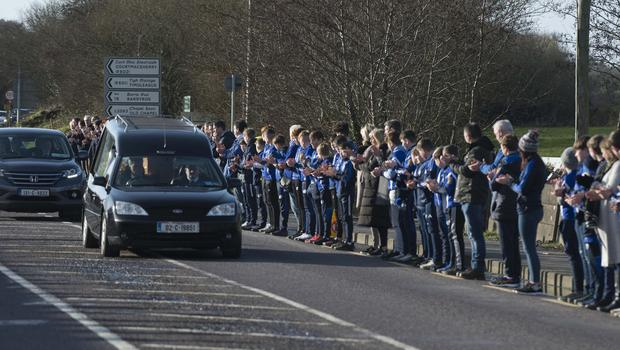 A special guard of honour lined the street as the funeral cortège passed Bandon Rugby Club. Photo: Michael Mac Sweeney/Provision